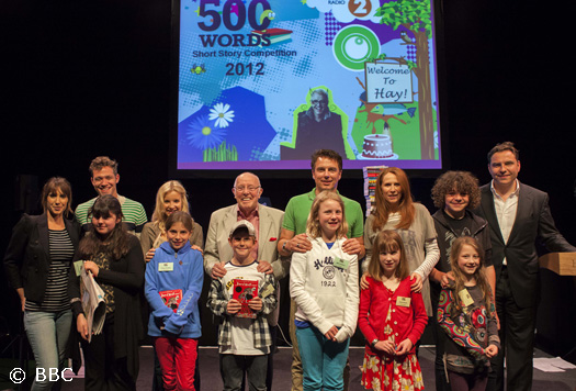 John with the presenters and winnners of the 500 Words Competition