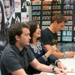 Gareth, Eve and John signing in Cardiff
